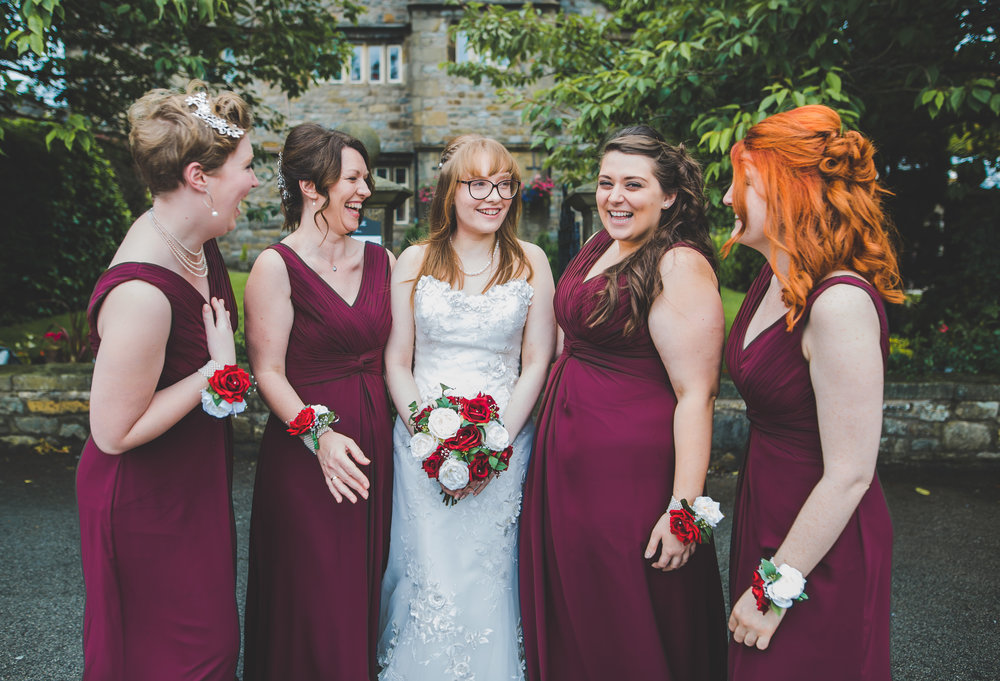 All of the bridesmaids and the groom outside of their wedding venue,  Stirk House Hotel- Lancashire wedding photography