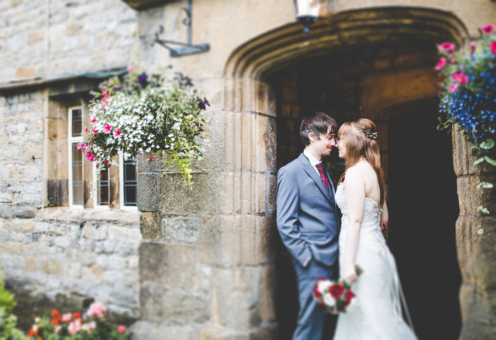 The bride and groom in the doorway of Stirk House Hotel, Creative wedding photography in lancashire