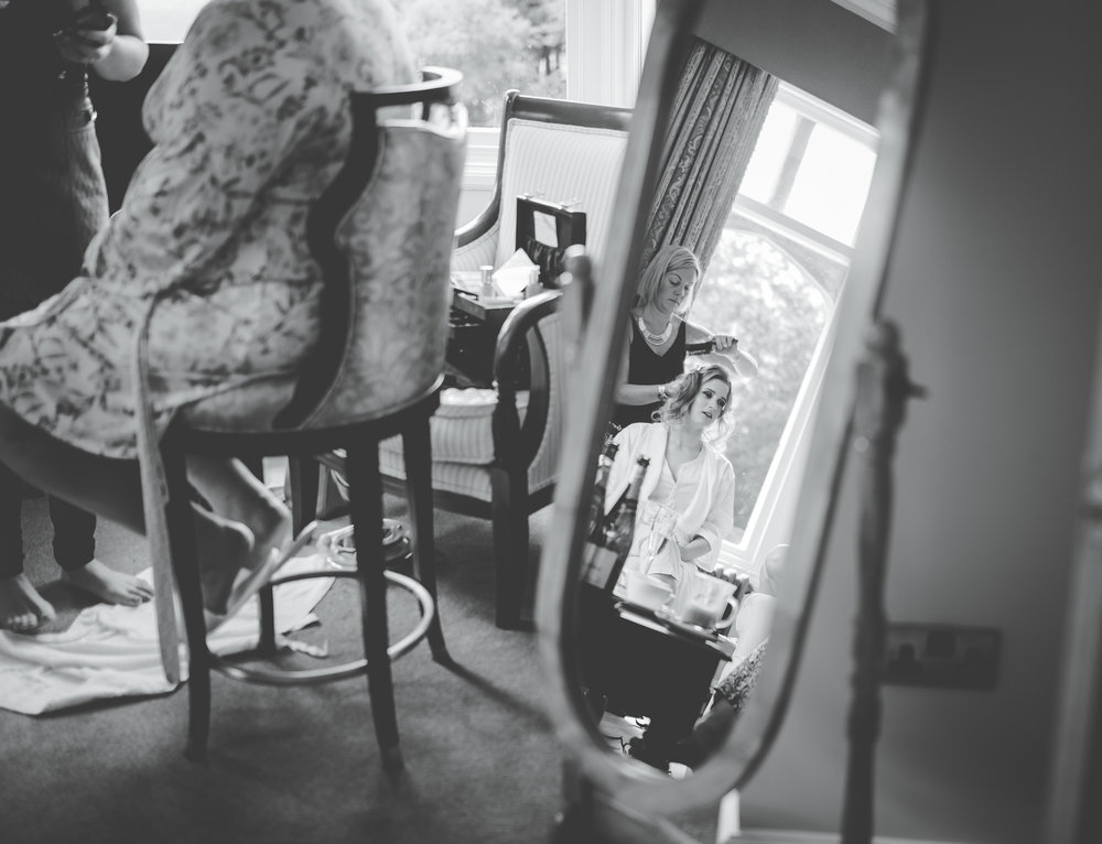 A mirror photo of the bride getting ready- Creative wedding photographer