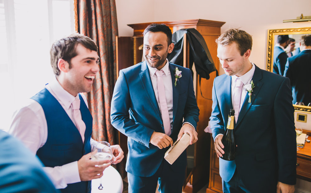 The groom and groomsmen getting ready- Villa at Levens for a wedding