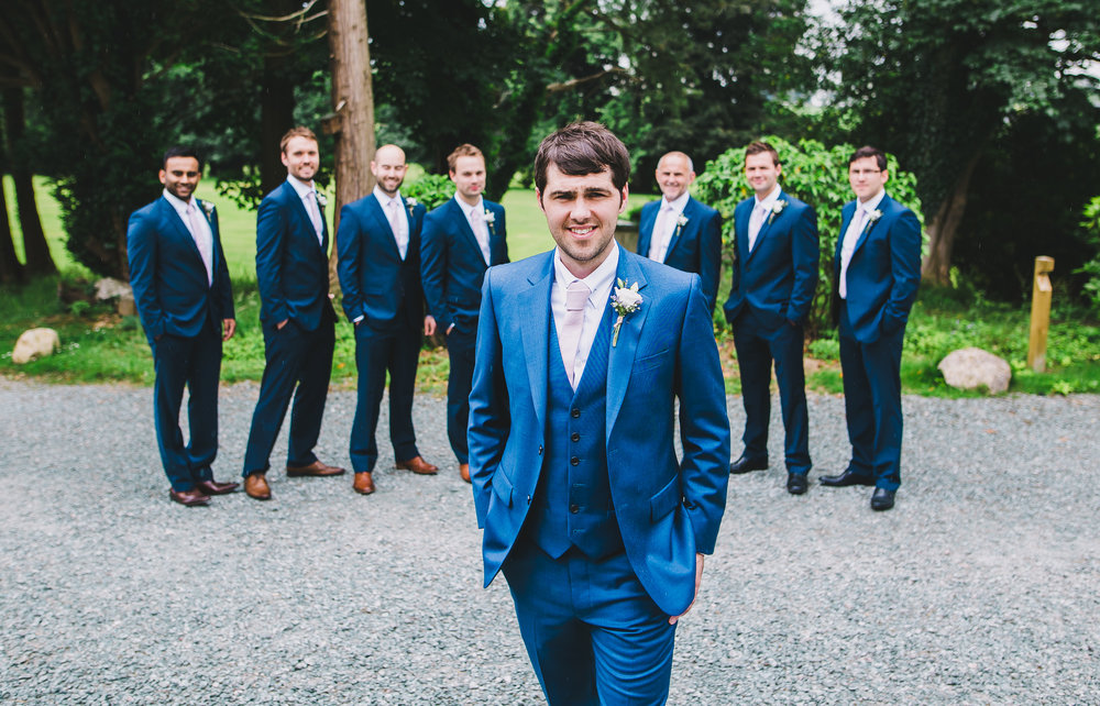 Creative photo of the groom surrounded by his groomsmen