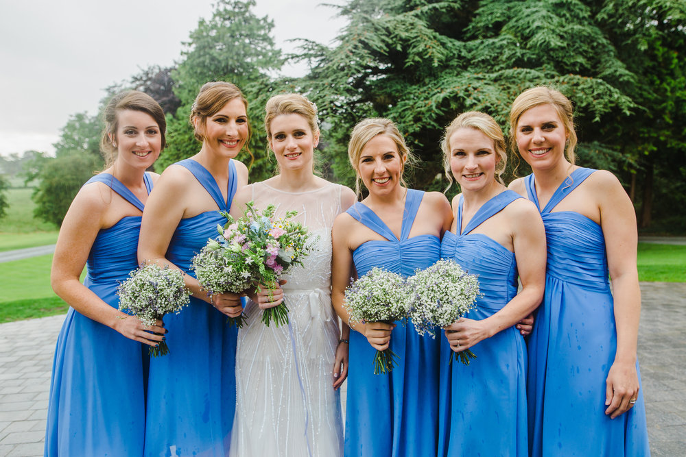 The bride surrounded by her bridesmaids- Relaxed wedding photography