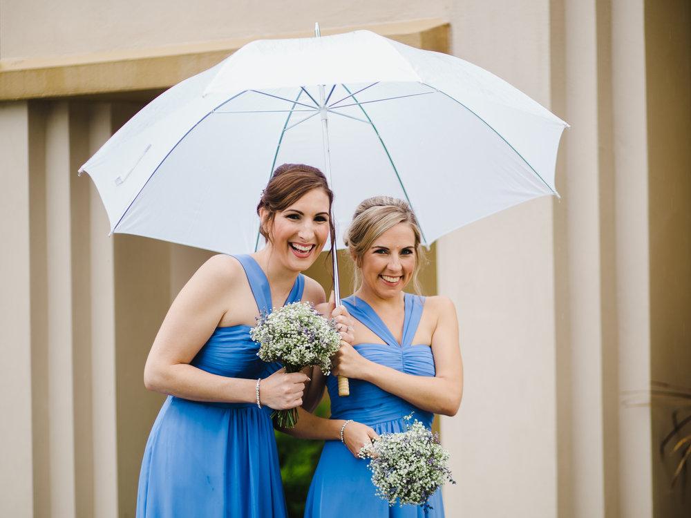 Two of the bridesmaids under the umbrella at Villa at Levens