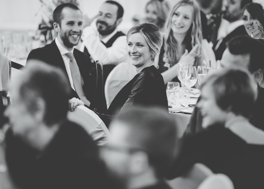Smiling guets as they listen to the wedding speeches- Villa at Levens, Lake district