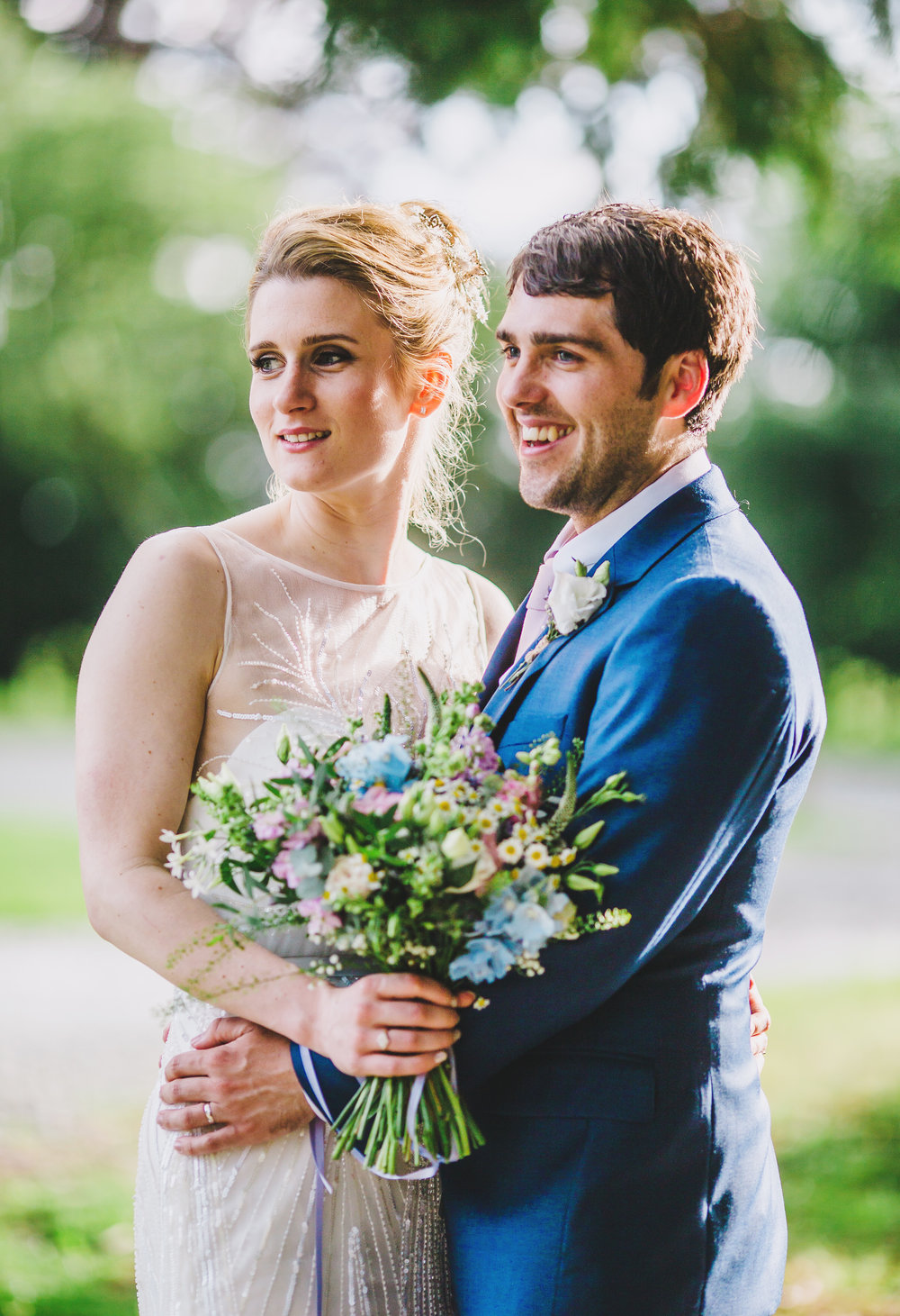 Portrait of the bride and groom at Villa at Levens surrounded by the sun setting