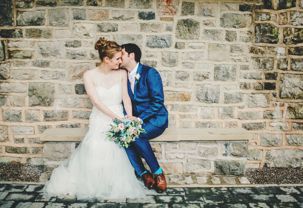 A kiss on the check from groom to bride, Villa at Levens wedding venue