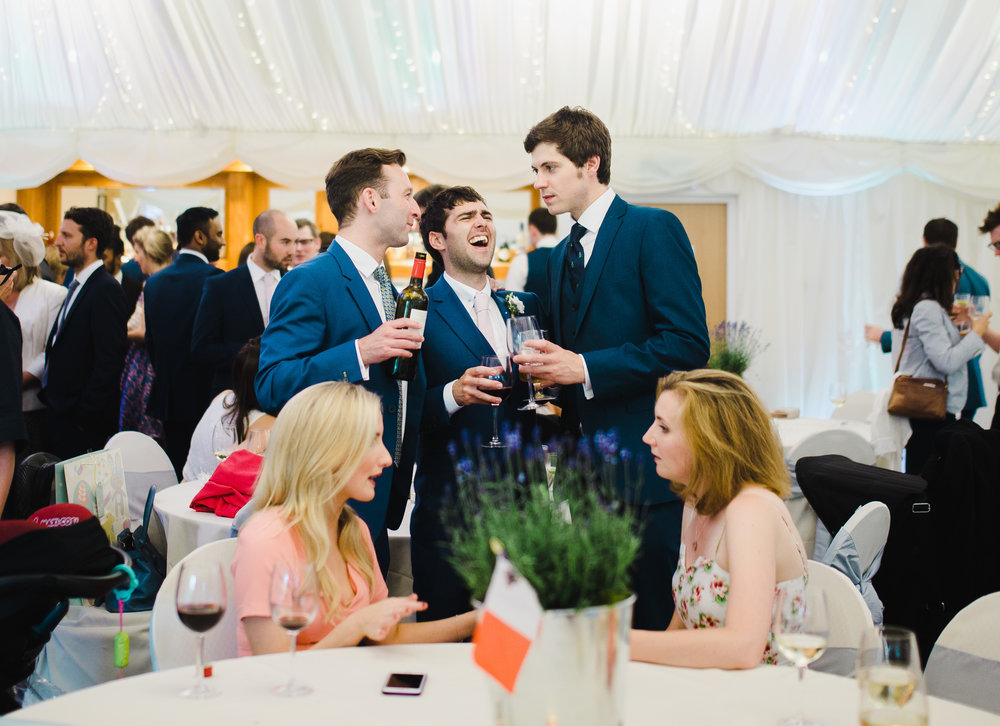 Smiles and laughter from the groomsmen- Relaxed wedding photographer