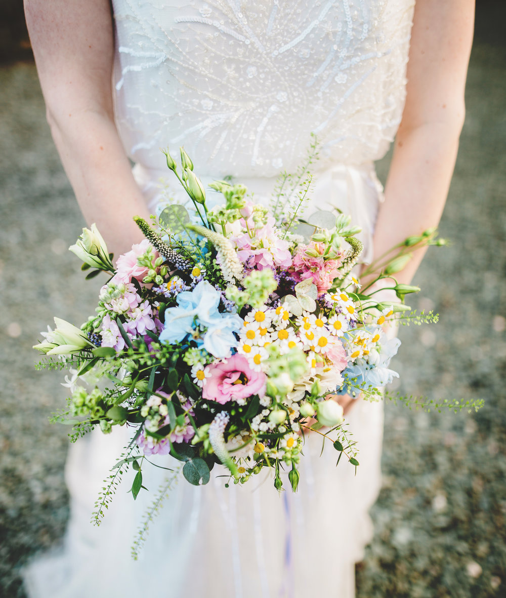 The bride holding her flower bouquet- Wedding photography at Villa at Levens