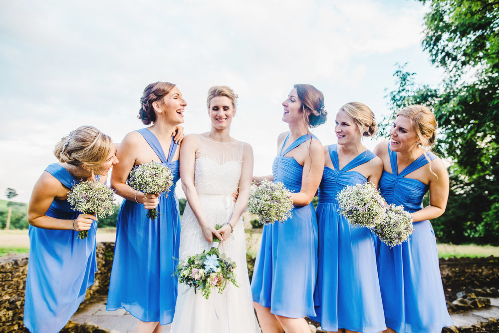 The bride with her bridesmaids outside The Villa at Levens in the sun