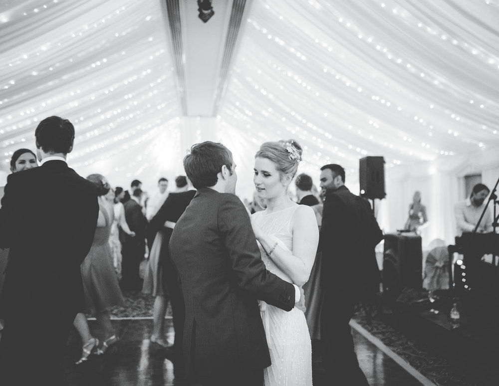 Black and white documentary photography of the bride and grooms first dance at Villa at Levens