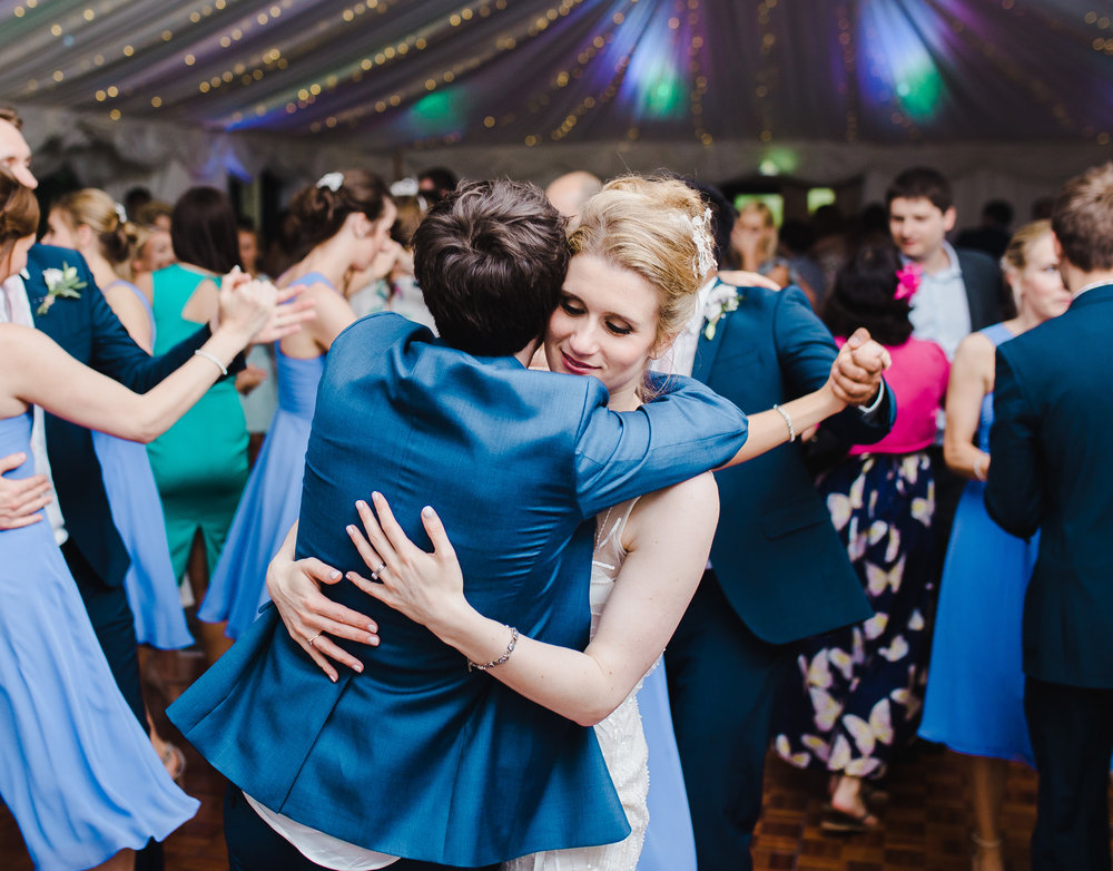The newly weds hugging on the dance floor- Documentary wedding photographer in the Lake District