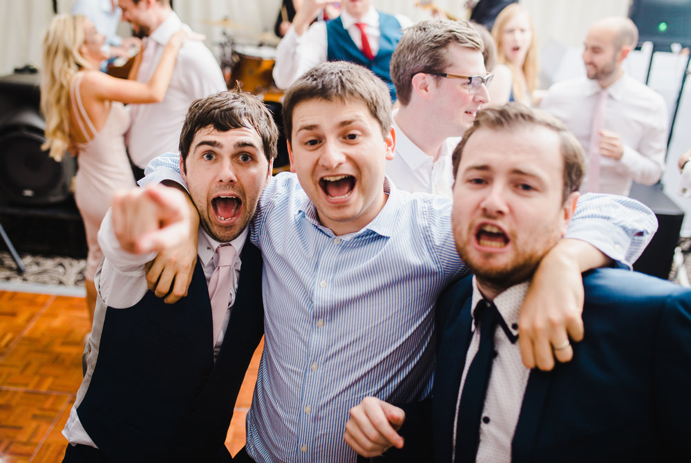 Documentary wedding photograph of the guest having the time of their life- Wedding venue of Villa at Levens