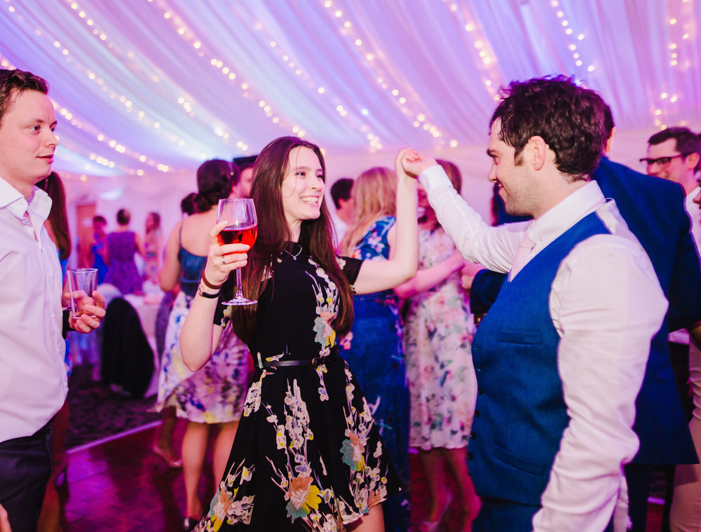 The dance floor filled with wedding guest- Modern wedding photographer