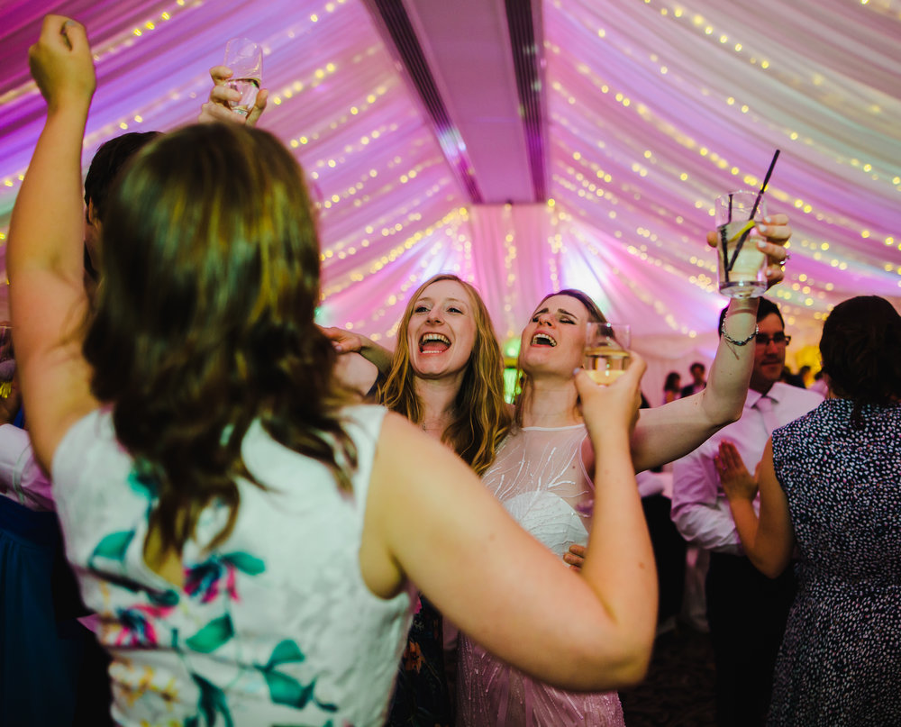 Big cheers from the wedding guest on the dance floor- Creative wedding photographer in the Lake District.
