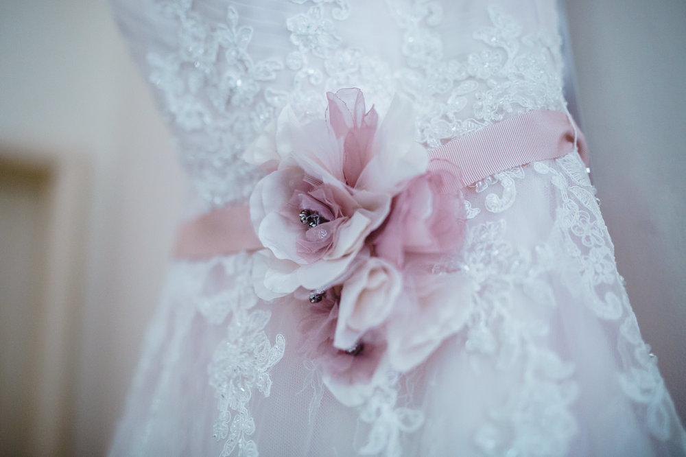 A small detail of the brides gown, vintage themed wedding at Samlesbury Hall