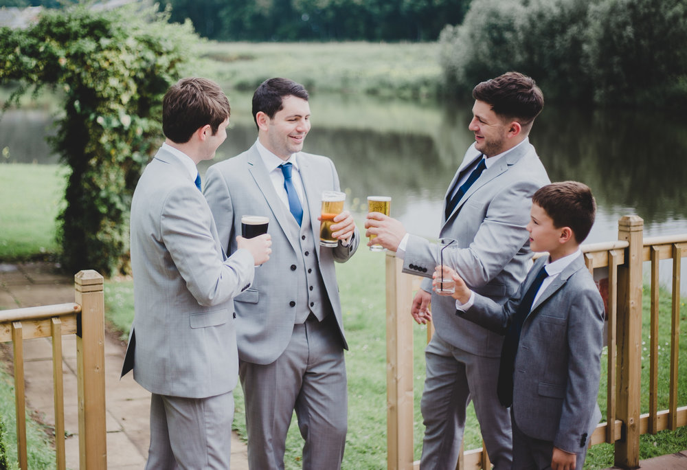 The groom and two of his groomsmen outside of the wedding venue, Samlesbury Hall.