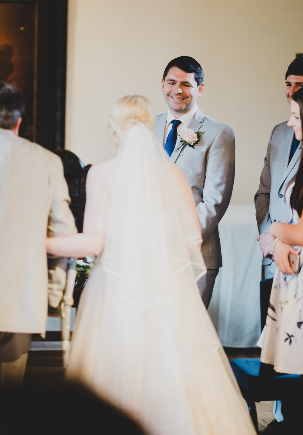 Big smiles from the groom as he watches his bride down the aisle. - preston wedding photography