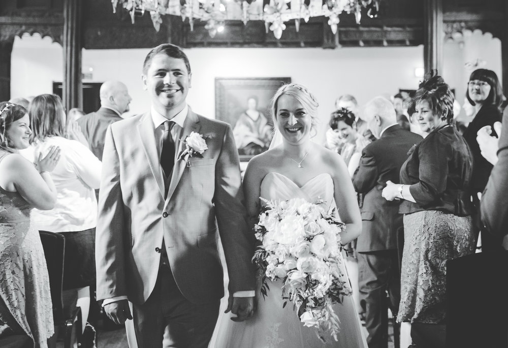 The bride and groom walking back down the aisle- Black and white wedding photography