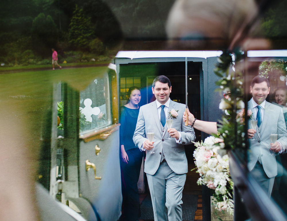 Reflection of the groom getting into his wedding car- Creative wedding photography