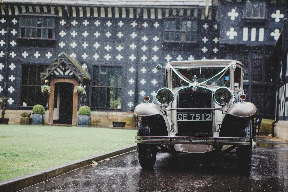 The wedding car outside of Samlesbury Hall- Rustic wedding