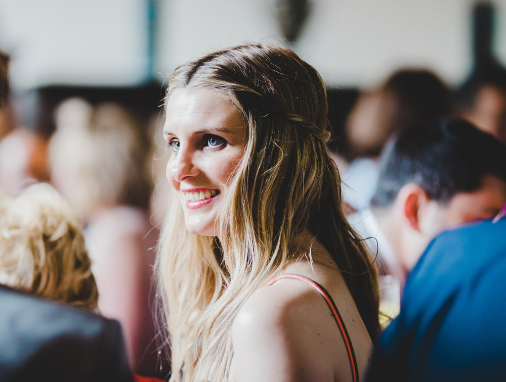 Smile from one of the wedding guests of the Samlesbury Hall wedding.