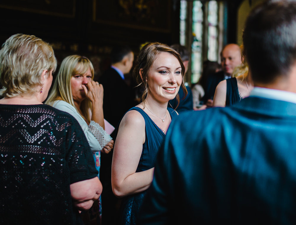 One of the bridesmaids in a crowed of other wedding guest at the Preston wedding
