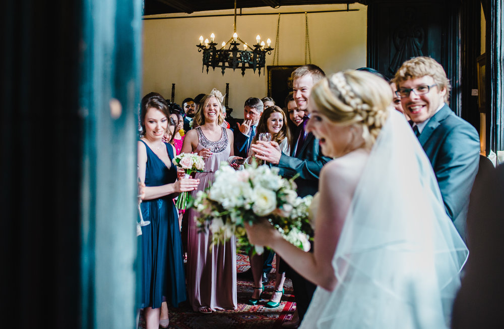 Documentary photography of the bride and her wedding guest as she enters the room- Lancashire wedding photography