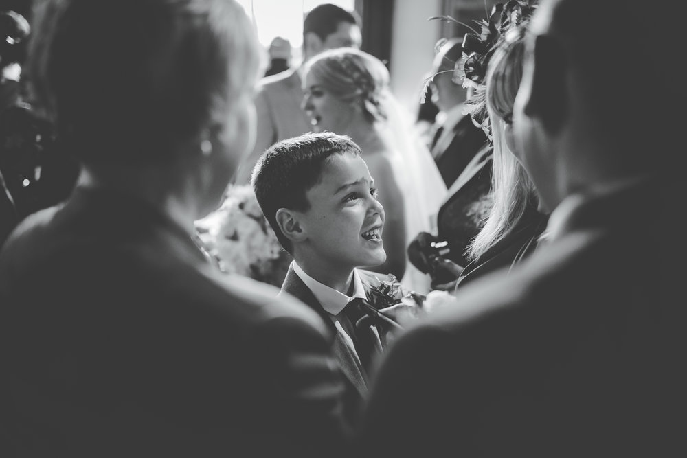 Black and white photo of one of the wedding guest, black and white photo- Relaxed wedding photographs