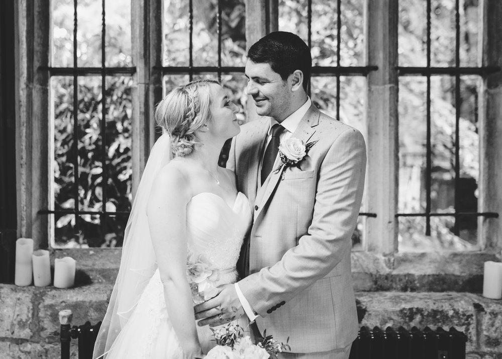 Bride and groom gazing into their eyes lovingly, Documentary wedding photographer
