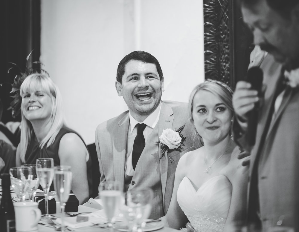 laughter from the groom as the speeches are being said- relaxed wedding photography in preston