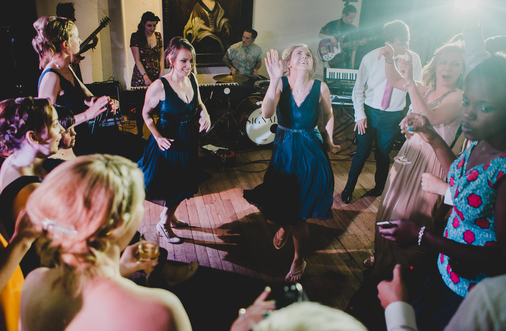 The wedding guests on the dance floor at Samlesbury Hall- Preston for a wedding
