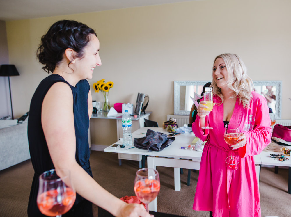 The bride talking to one of the bridesmaids- Relaxed wedding photography