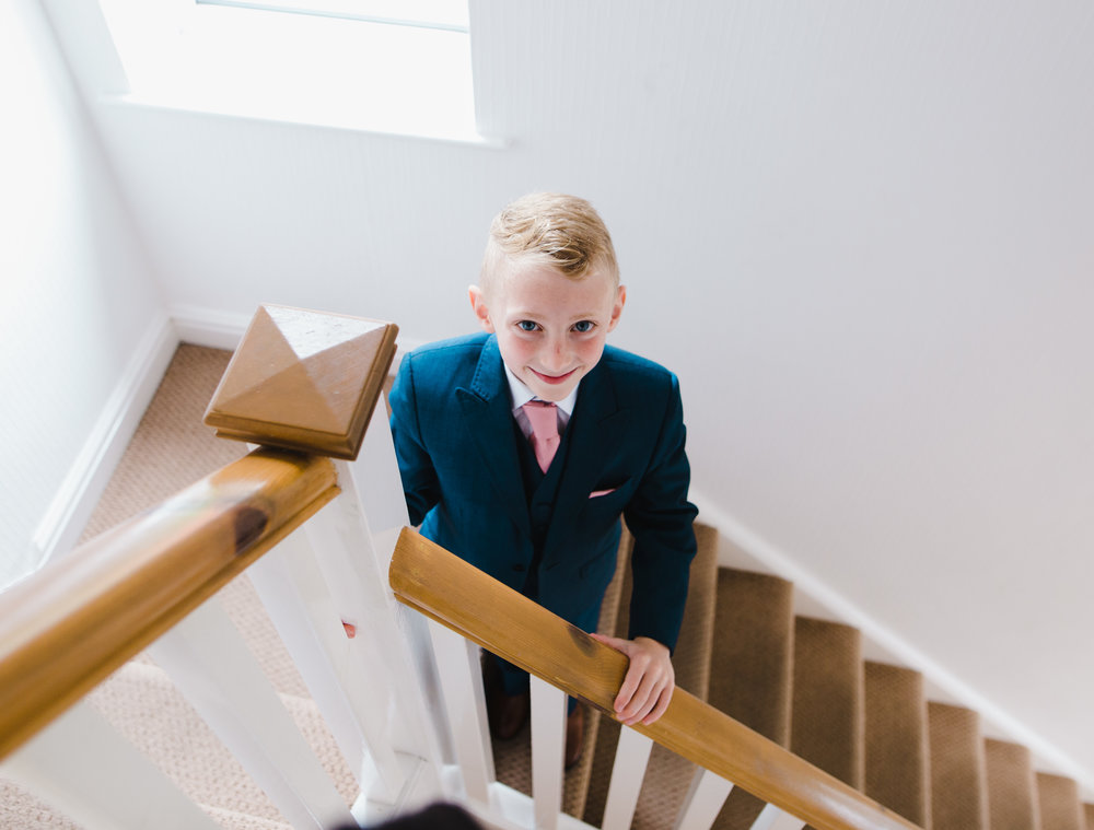 Documentary wedding photography of one of the little of smiling- Lancashire wedding photography