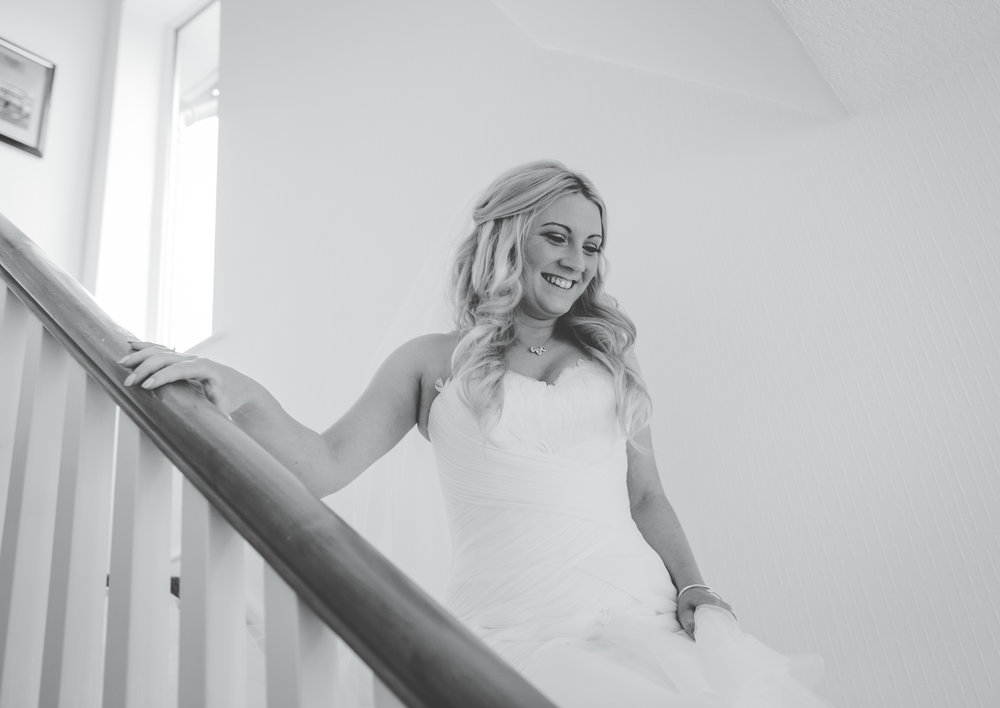 The bride walking down the stairs, black and white photography- Creative wedding photography