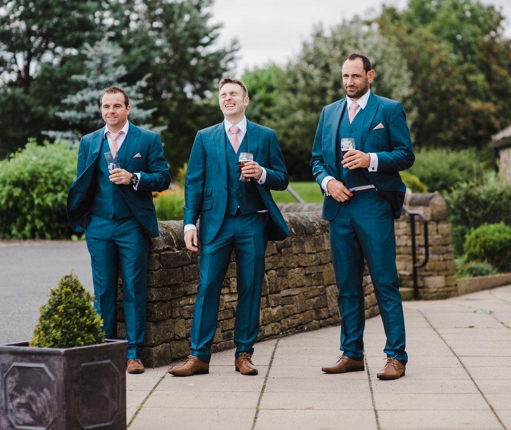 The groom and groomsmen outside of the wedding venue, The White Hart Inn at Lydgate