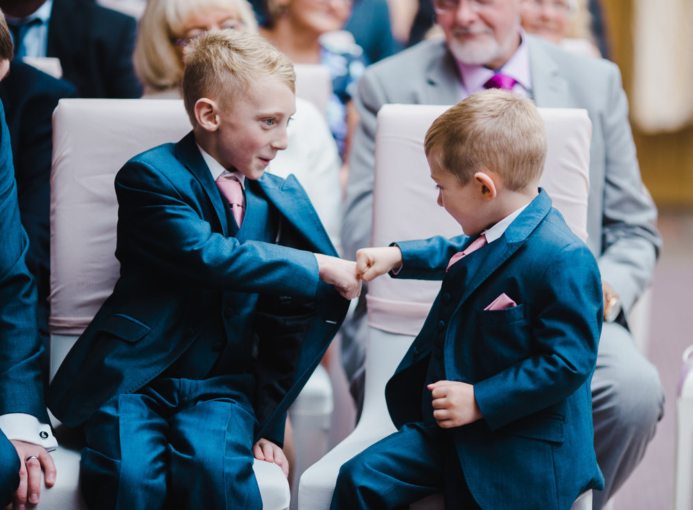 A special hand shake for two of the wedding guests- Modern relaxed wedding