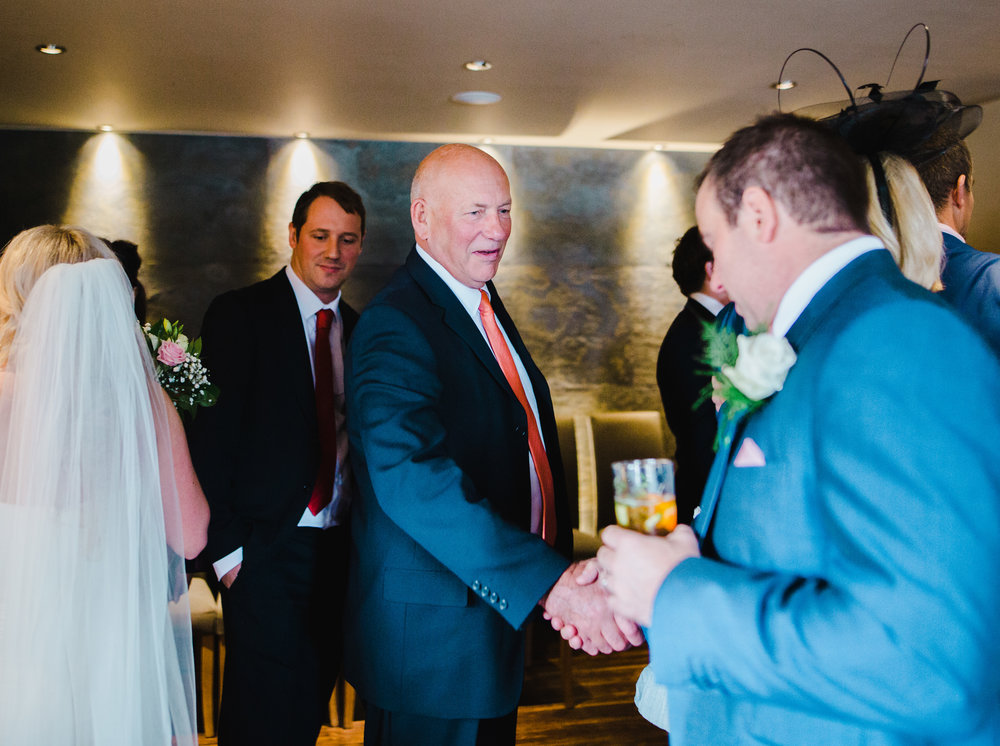 The groom and groomsmen enjoying a pint- Manchester wedding at The White Hart Inn at Lydgate