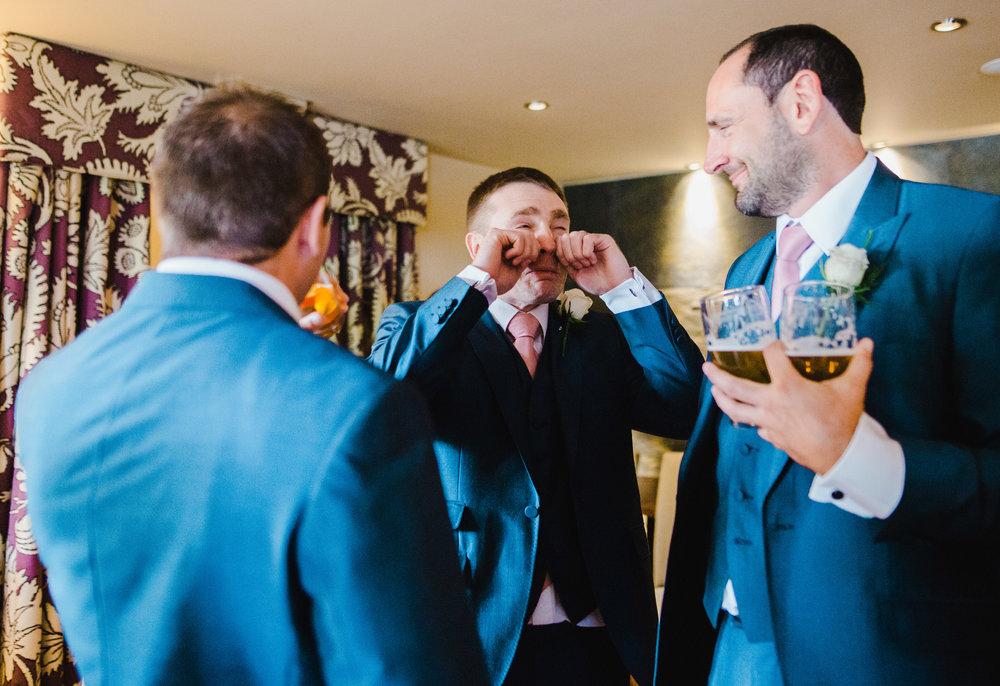 Smiles from the groomsmen at The White Hart Inn at Lydgate