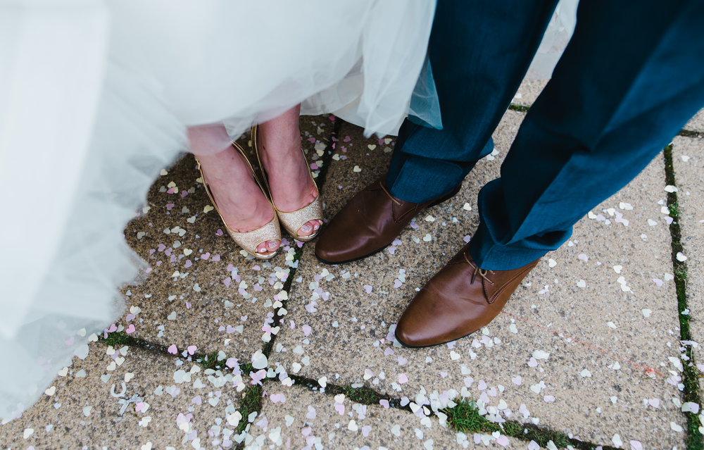 Creative image of the bride and groom footwear of choice