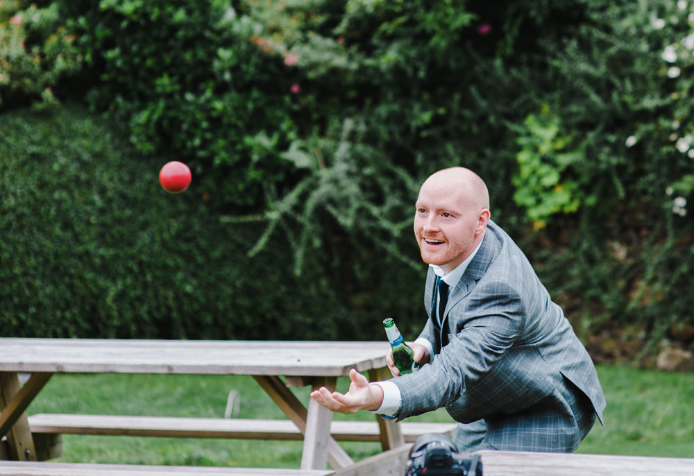 One of the wedding guest going to catch the ball- Documentary wedding photography