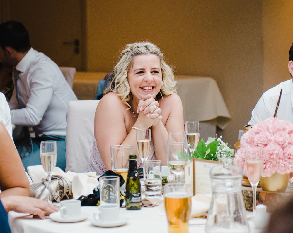 Big smile from the bride during the wedding speeches- creative wedding photographer