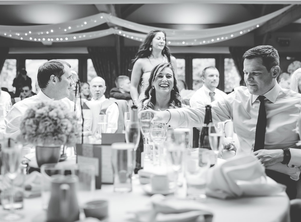 Black and white photograph of the wedding guest sat at the tables- The White Hart Inn at Lydgate