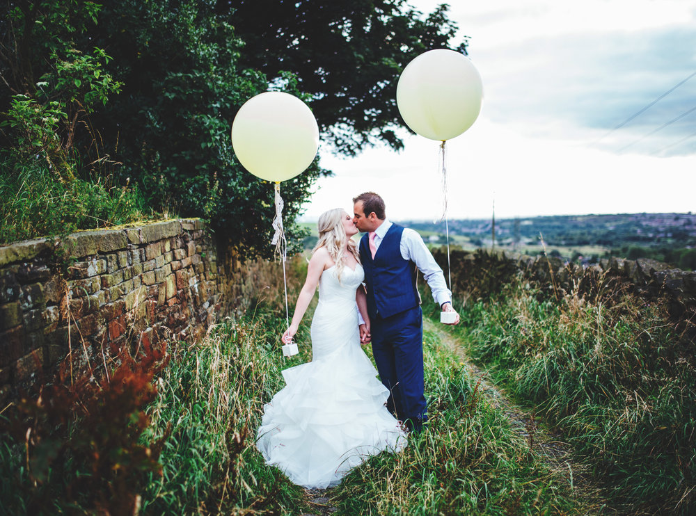 striking portraits outside The White Hart at Lydgate - wedding photography in the north west