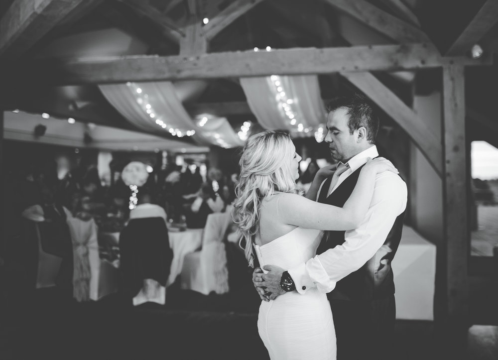 Black and white image of the bride and groom at The White Hart Inn at Lydgate