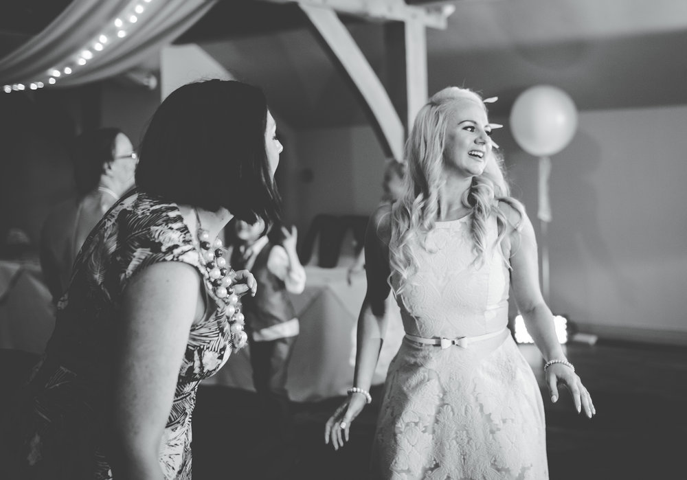 black and white image of the bride on the dance floor- The White Hart Inn at Lydgate