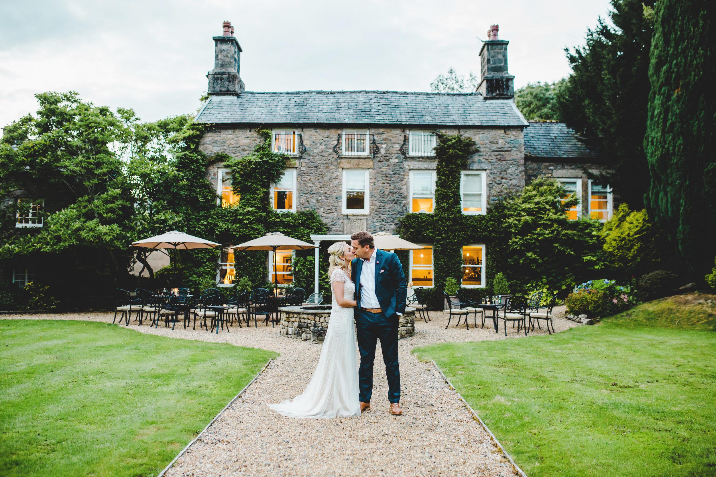 wedding couple outside Hipping Hall - Lake District wedding photography