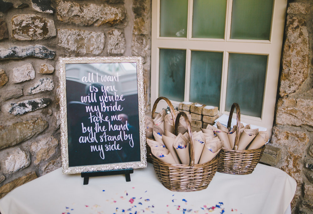 Exterior table arrangement of confetti at Hipping Hall Kirkby Lonsdale for a wedding.
