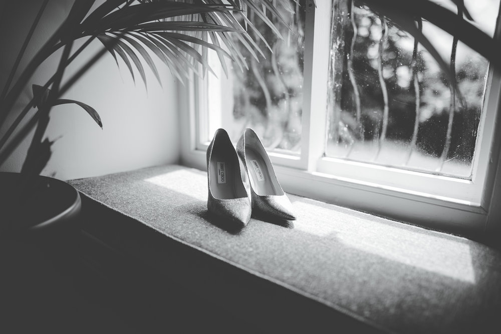 The shoes which the bride will where to walk down the aisle.- Wedding pictures at hipping hall.