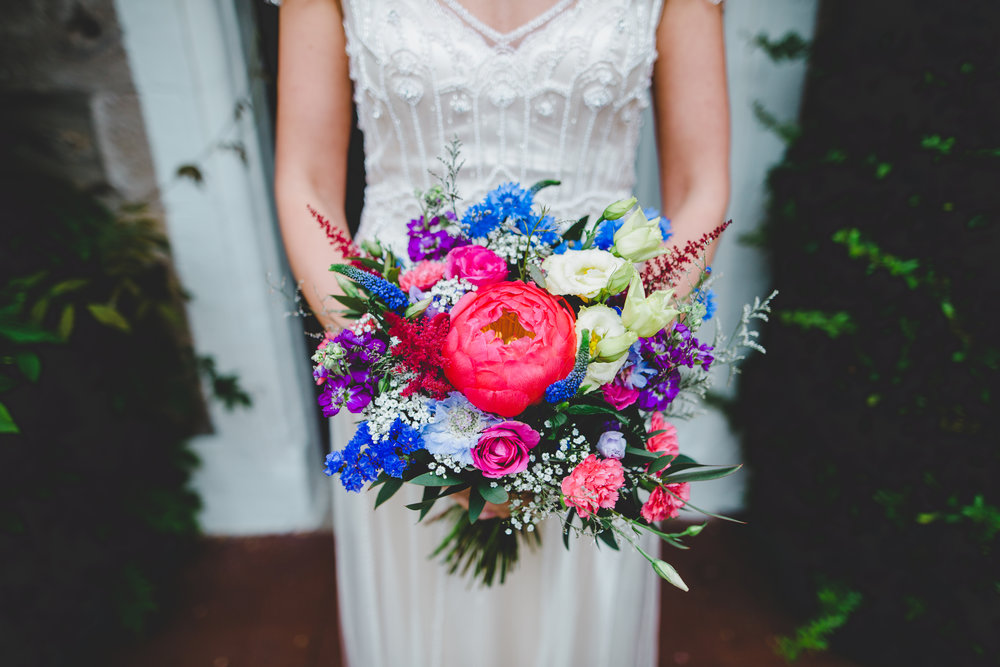 The colourful flowers being held by the bride- Documentary wedding photography