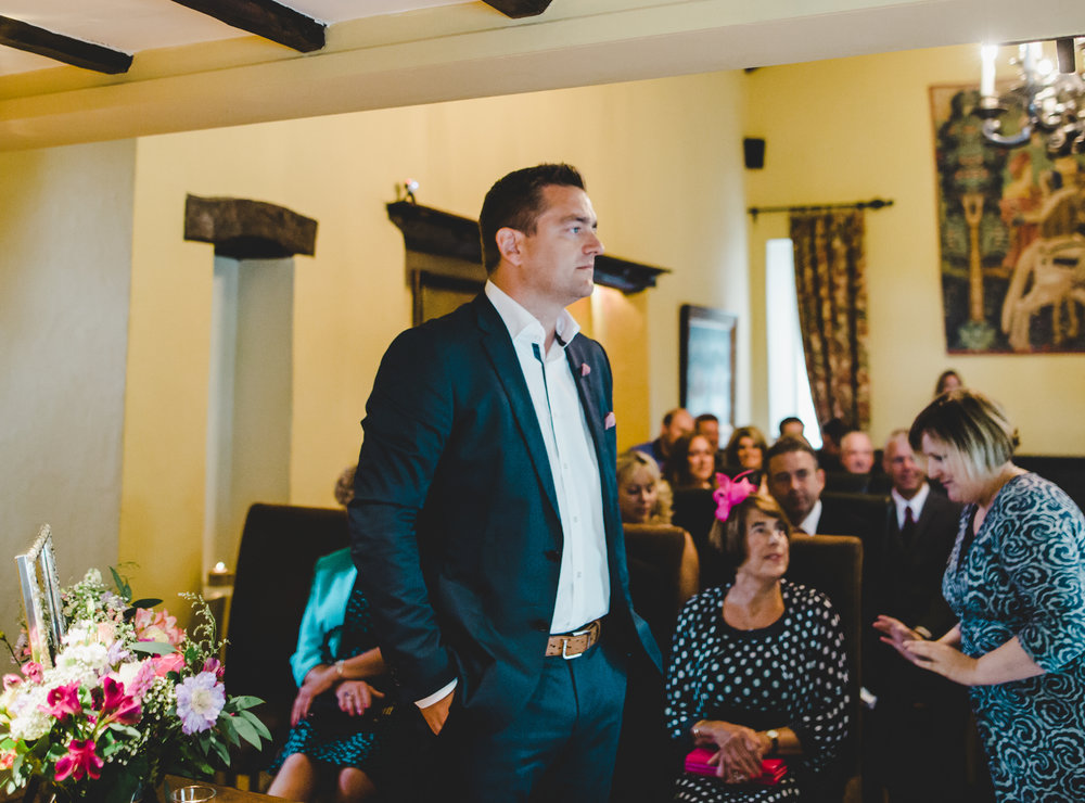 The groom waiting at the alter.- Documentary wedding photography at the lake district